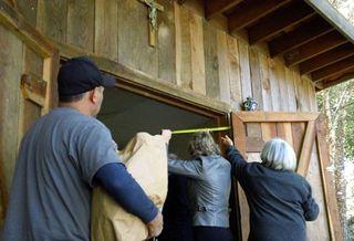 Nancy Clarkin from Half Moon Bay SVdP and Shella Bordi measure for a new sign